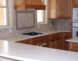 kitchen granite countertops with tiled backsplash