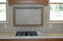A granite countertop with a custom backsplash.